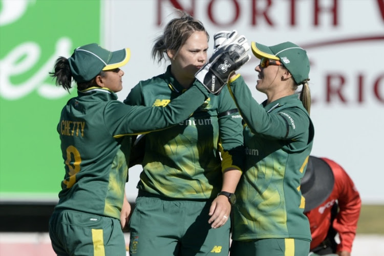 Trisha Chetty, Dane van Niekerk and Mignon du Preez of South Africa celebrate the wicket of Sanjida Islam of Bangladesh during 1st Womens ODI match between South Africa and Bangladesh at Senwes Park on May 04, 2018 in Potchefstroom, South Africa.