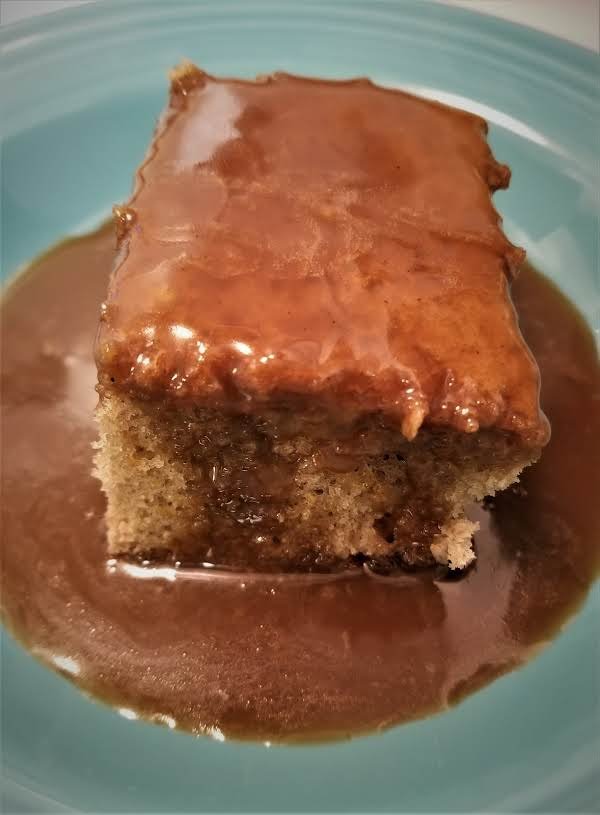 Moist And Delicious Spice Cake Served With A Warm Brown Sugar Sauce