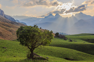 Photo: Drakensberg Sunset  After spending half a day hike up Rainbow Gorge, we rounded a corner and were greeted with this view just a few hundred metres away from our camp. The four snowcapped peaks in the distance are (from left to right) Inner Horn, Outer Horn, The Bell and Cathedral Peak. We tried to climb Cathedral Peak the following day but had to turn back just short of the summit due to dangerous conditions.  #AfricanTuesday Magnificent Mountains by +Dick Whitlock, +Grobler du Preezand +Morkel Erasmus(+African Tuesday)