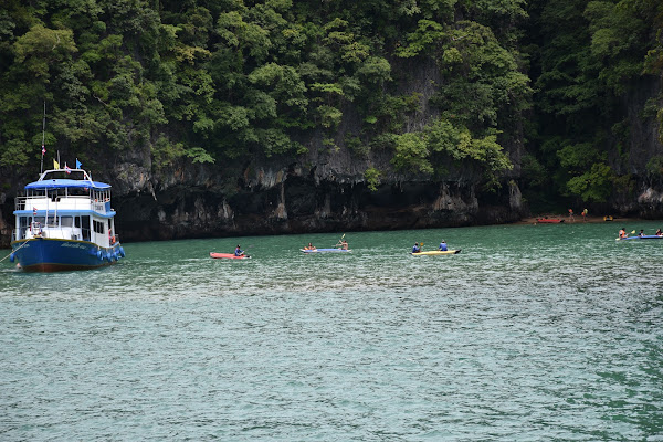 Start paddling along the lush green coastline of Koh Panak