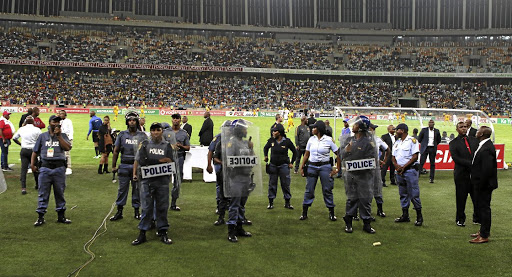 Police assemble on the side of the pitch during the Free State Stars-Kaizer Chiefs match at Moses Mabhida Stadium in Durban on Saturday. Picture: ANESH DEBIKY/GALLO IMAGES