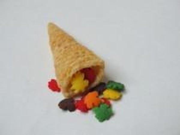 For the cornucopia:  1.  Attach Bugle chip to the middle of the graham cracker...