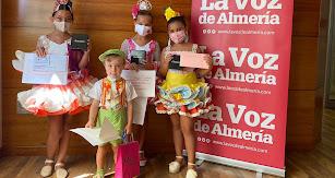 Los ganadores del Concurso de Trajes Flamencos 2021 en la categoría infantil y la más salerosa.
