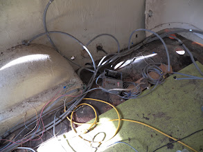 Photo: We'll eventually have to make sense of this tangle of wires and pipes.