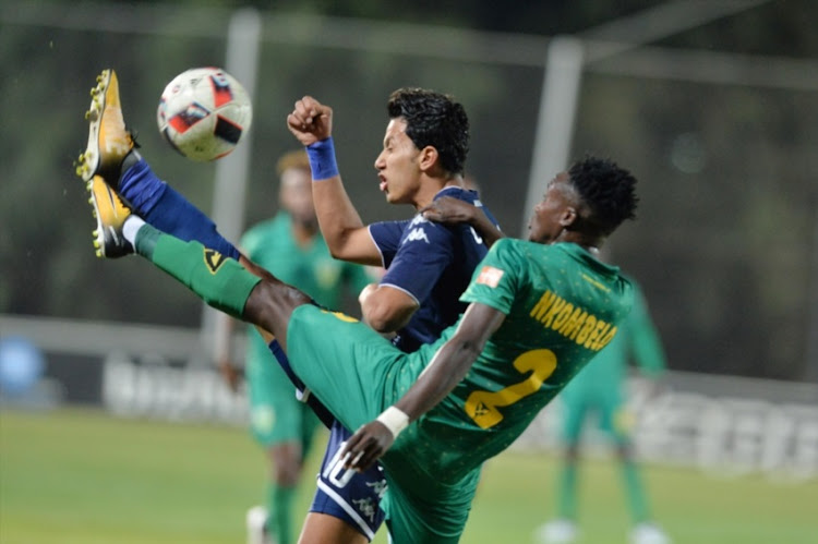 Amr Gamal and Zolani Mzava during the Absa Premiership match between Bidvest Wits and Golden Arrows at Bidvest Stadium on September 13, 2017 in Johannesburg.