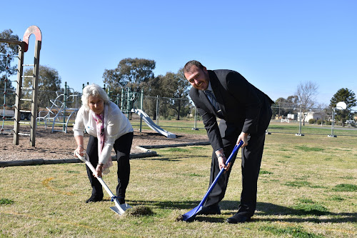 Narrabri Shire Council Mayor Cathy Redding and general manager Stewart Todd turning the first sod at the pirate playground on Tuesday.