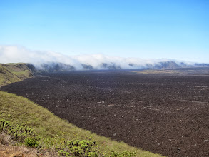 Photo: Clouds spilling over the south side of the caldera