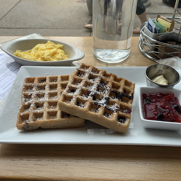 Blueberry Belgian Waffle with fruit compote and a side of scrambled eggs. Num!