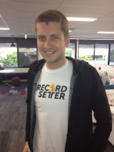 Photo: Matt from Allianz shows of his Geek Shirt. Want to know what he set the record for? Check it out here: http://www.urlesque.com/2011/03/08/worlds-longest-high-five-urdb-feat-of-the-week/