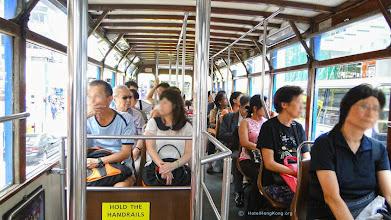 Photo: Passengers inside Hong Kong tram