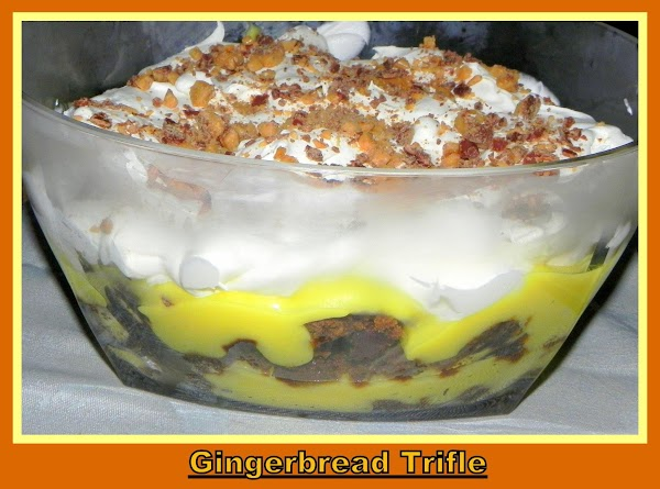 Cut gingerbread into cubes. Arrange one-third of gingerbread cubes in a 3-quart trifle bowl;...