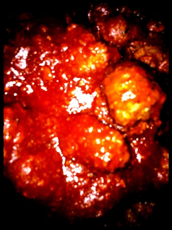 For the meatballs, add barbeque sauce to the Dutch oven.