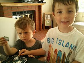 Photo: Clark and Finn Help Upgrade a Wifi Card