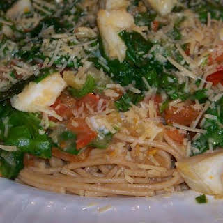 Colorful Tomato and Spinach Seafood Pasta.