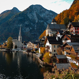 Hallstatt in Autumn by Justin Hyder - City,  Street & Park  Vistas ( alps, yellow, holiday, scene, beautiful, hallstatt, mountain, view, world, fall, unesco, cottage, austrian, season, vacation, landmark, village, europe, halstatt, famous, reflection, town, nature, tree, heritage, tranquil, water, morning, outdoor, salzburg, hill, outdoors, background, alpine, austria, autumn, travel, lake, colorful, landscape )