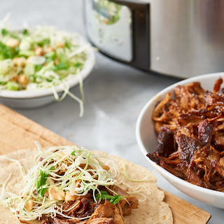 Slow-Cooked Hoisin and Ginger Pork Wraps with Peanut Slaw.