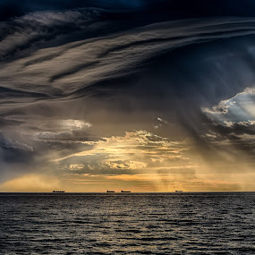 Storm on the Horizon by Gary Tindale - Landscapes Cloud Formations ( clouds, sunset, ocean, storm, evening, rain,  )