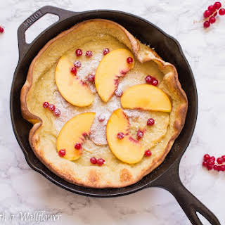 Vanilla Dutch Baby Pancake with Red Currants and Peaches.