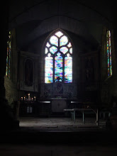 Photo: The chapel interior is very simple, with some more recent stained glass.