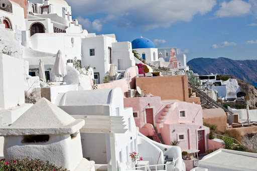 Oia-Santorini-2.jpg - Pink and white buildings hew to the cliffside in Oia along Santorini's caldera, looking south.
