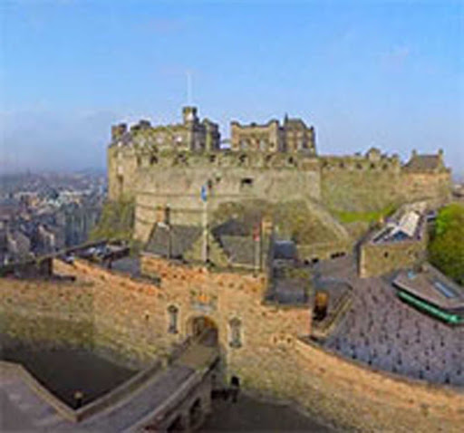 Edinburgh Castle is a historic fortress that dominates Edinburgh's skyline from its position on the Castle Rock in Scotland.