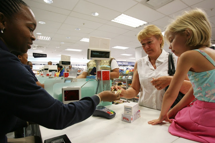 Stella Fermor and her grandaughter Danielle Bar-Yoseph using a Clubcard at Clicks in Vincent Park. Picture: NIGEL LOUW/Daily Dispatch