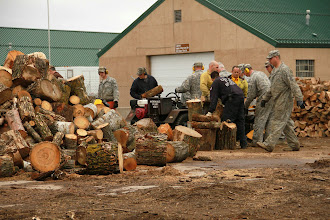 Photo: Soldiers and civilian employees from various agencies split wood during Earth Day clean-up May 9, 2013.  The split wood comes from fallen trees taken down during the extreme winter or heavy winds, and giving to families in need for wood burning heat. http://www.minnesotanationalguard.org/press_room/e-zine/articles/index.php?item=4402