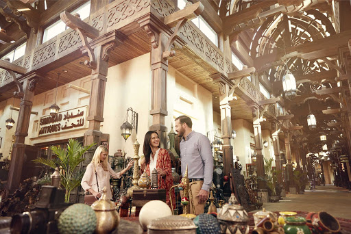 Stroll through the eye-catching Souk Madinat market in Dubai.