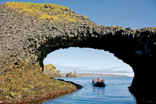 Lindblad-Expeditions-Iceland-Natural-Arch-Basalt.jpg - Take a Zodiac boat cruise under a natural arch of basalt on a Lindblad Expeditions adventure.