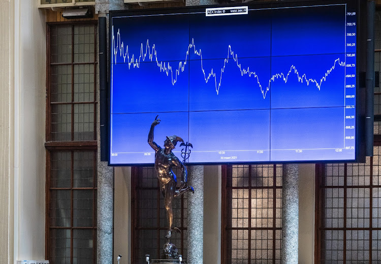 A statue of Mercury, the Roman god of trade, in front of the AEX Index curve in the Euronext NV stock exchange in Amsterdam, Netherlands. File photo: BLOOMBERG/PETER BOER