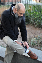 Photo: Mohammad Mahoub cutting off his GPS anklet after a recent Federal Court ruling lifted many of his remaining bail conditions.