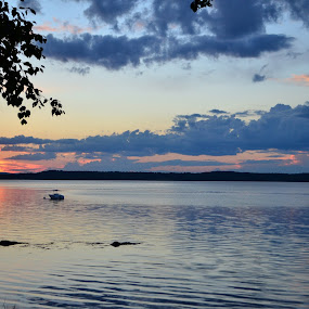 puffy clouds at sunset by Lisa Holden - Landscapes Cloud Formations ( clouds, water, orange, bay, puffy )