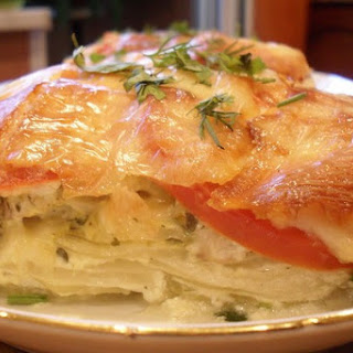 Potatoes with Fish under a cheese crust
