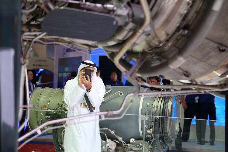 A visitor takes a photo of an aircraft engine at the Dubai Air Show in Dubai, United Arab Emirates. Picture: REUTERS/SATISH KUMAR