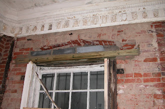 Photo: January 2004 - Month 5: Living Room front window condition - rotted! Detail of crown molding.