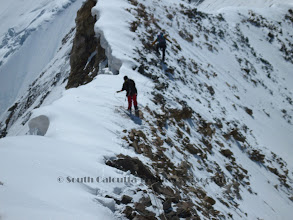 Photo: Sherpas started rope fixing on the NW ridge.. notice the huge cornices at left side of the ridge