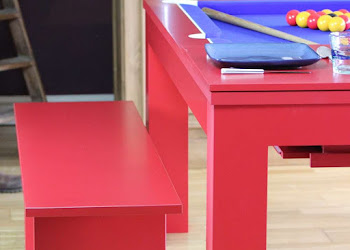 Red Dining Table Bench Next to a Red convertible dining and pool table