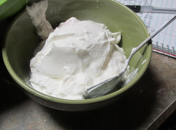 Next add the room temperature sour cream to mixture and continue beating to blend.