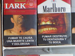 """Photo: """"Smoking causes a slow and painful death."""" """"Smoking destroys your teeth and your mouth."""""""