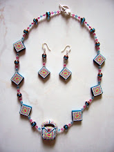 "Photo: PCC- 105 Necklace and earrings set. Polymer Clay cane beads with crystal and glass beads. 20.5"" $69.00"
