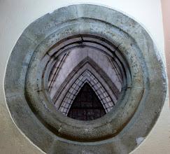 Photo: View of interior through a round window