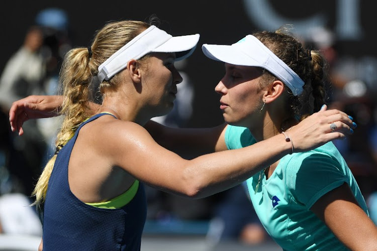 Denmark's Caroline Wozniacki (L) speaks with Belgium's Elise Mertens after winning their women's singles semi-finals match on day 11 of the Australian Open tennis tournament in Melbourne on January 25, 2018.