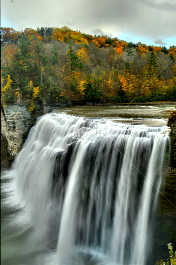 Letchworth Middle Falls by Jim Davis - Landscapes Waterscapes ( water, orange, sky, red, reivers, cloud covered, blue skies, water falls, streams, creeks, autumn colors )
