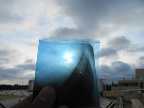 Photo: cloud playing hide seek with the venus transit from earth.