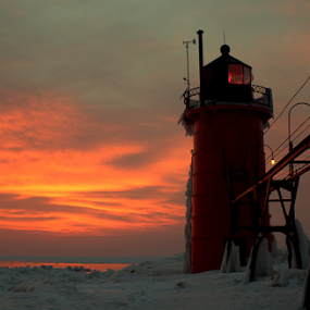 Benton Harbor Sun Shade by Theodore Schlosser - Landscapes Sunsets & Sunrises ( clouds, benton harbor, michigan, red, winter, ice, sunset, lighthouse, pier, mi )