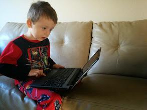 Photo: Finn on a Chromebook