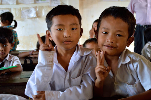 vietnam-schoolboys.jpg - Two inquisitive young boys in their schoolhouse in Vietnam. We stirred interested wherever we went.
