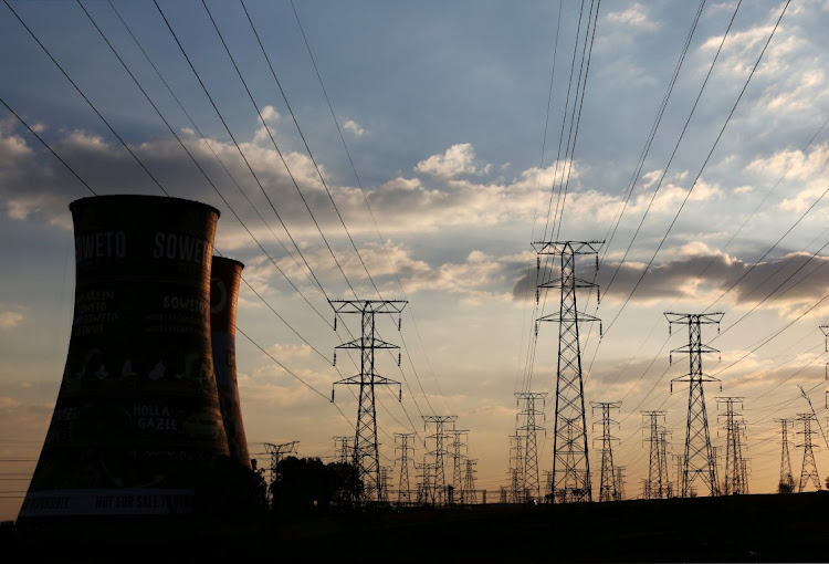 Electricity pylons are seen along the cooling tower of the defunct Orlando Power Station in Soweto. Picture: REUTERS/Siphiwe Sibeko