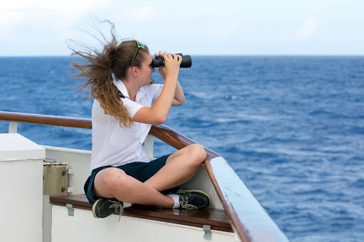 Deck cadet Lottie Astbury surveys the horizon from the bridge deck during a Wind Surf sailing.