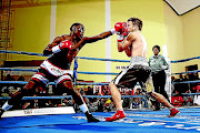 Xolisani Ndongeni  jabs Miguel Escalada  in their lightweight clash in this file picture.  photo: MARK ANDREWS/ Daily Dispatch
